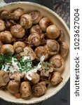 above view of fried champignons ...   Shutterstock . vector #1023627004