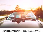 traveling by car   couple in... | Shutterstock . vector #1023630598