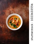 Stock photo tom yam kung spicy thai soup with shrimp seafood coconut milk and chili pepper in bowl copy space 1023633556