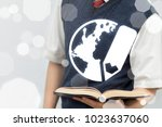 young student offers book with... | Shutterstock . vector #1023637060