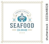 seafood restaurant logo vector... | Shutterstock .eps vector #1023648028
