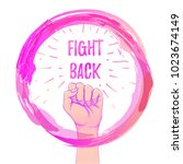 fight back. female hand with... | Shutterstock .eps vector #1023674149
