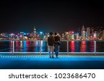lover stand in front of hong... | Shutterstock . vector #1023686470
