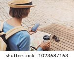 young traveller woman sitting... | Shutterstock . vector #1023687163