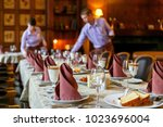 waiters prepare a table for... | Shutterstock . vector #1023696004