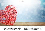 abstract red heart on wooden... | Shutterstock .eps vector #1023700048