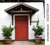 red old door | Shutterstock . vector #1023700219