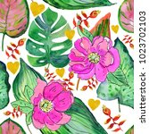 tropical flowers and leaves.... | Shutterstock . vector #1023702103