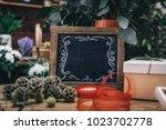 blank charcoal board among...   Shutterstock . vector #1023702778