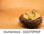 gold bars on nest concept of... | Shutterstock . vector #1023709969