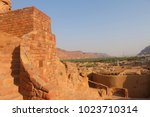 Small photo of Al-Ula, Saudi Arabia - September 23, 2017: Stairs leading to the AlUla Fort with the old town comprised of mudhouses seen below.