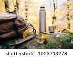 backpack and thermos on fallen... | Shutterstock . vector #1023713278