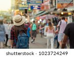 back side of young asian... | Shutterstock . vector #1023724249