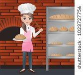 female baker holding loaf  | Shutterstock .eps vector #1023727756
