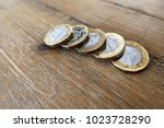 five british uk pound coins on... | Shutterstock . vector #1023728290