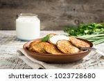 draniki   potato fritters.... | Shutterstock . vector #1023728680
