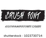 handwritten script font. hand... | Shutterstock .eps vector #1023730714
