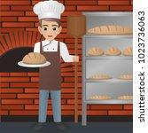 male baker holding loaf | Shutterstock .eps vector #1023736063