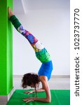 woman practice handstand... | Shutterstock . vector #1023737770