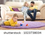 parents sit on the couch.... | Shutterstock . vector #1023738034