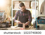 young  caucasian carpenter... | Shutterstock . vector #1023740830