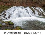 Small photo of Waterfall abounding in water in the spring