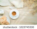 white cup of espresso coffee... | Shutterstock . vector #1023745330