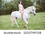 lovely cute woman is riding a... | Shutterstock . vector #1023749158