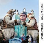 Small photo of CANTU - ITALY - February 11, 2018: Allegorical float called a Tears of ice. The glaciers are melting and the planet is rebelling. Pierrot in tears depicts human consciousness. Carnival of COMO LAKE