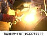pipe welding and welders | Shutterstock . vector #1023758944