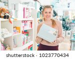 female buyer with gift box with ...   Shutterstock . vector #1023770434