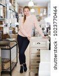 female standing near commode in ... | Shutterstock . vector #1023770464