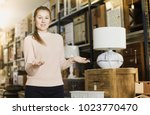 female standing near commode in ... | Shutterstock . vector #1023770470