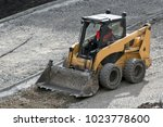 yellow wheel skid steer loader... | Shutterstock . vector #1023778600