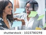 smiling business women...   Shutterstock . vector #1023780298