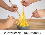 people eat the yellow stir... | Shutterstock . vector #1023798019
