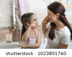 little kid girl and mom... | Shutterstock . vector #1023801760
