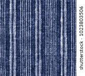 abstract folk striped motif in... | Shutterstock . vector #1023803506
