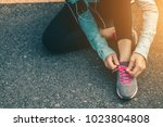 women tied up the shoe laces... | Shutterstock . vector #1023804808