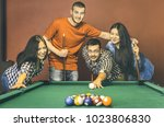 young friends playing pool at...   Shutterstock . vector #1023806830