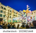 Small photo of VALENCIA, SPAIN- MARCH 15, 2015: Crowd observe El Pilar Falla in Valencia at dusk, the Fallas is a typical celebration where monuments are built for being burnt in Valencia, Spain