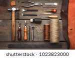 set of leather craft tools on... | Shutterstock . vector #1023823000