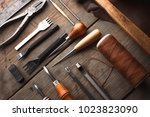set of leather craft tools on... | Shutterstock . vector #1023823090