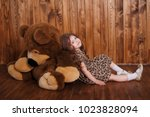 a little girl in a leopard...