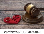wedding rings on the figure of...   Shutterstock . vector #1023840880