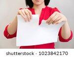 girl tearing a piece of paper... | Shutterstock . vector #1023842170