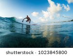 surfer rides the wave. extreme... | Shutterstock . vector #1023845800