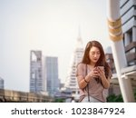 young asian woman using... | Shutterstock . vector #1023847924