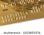 fragment of a bank plastic gold ... | Shutterstock . vector #1023855376