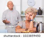 elderly upset woman sitting... | Shutterstock . vector #1023859450